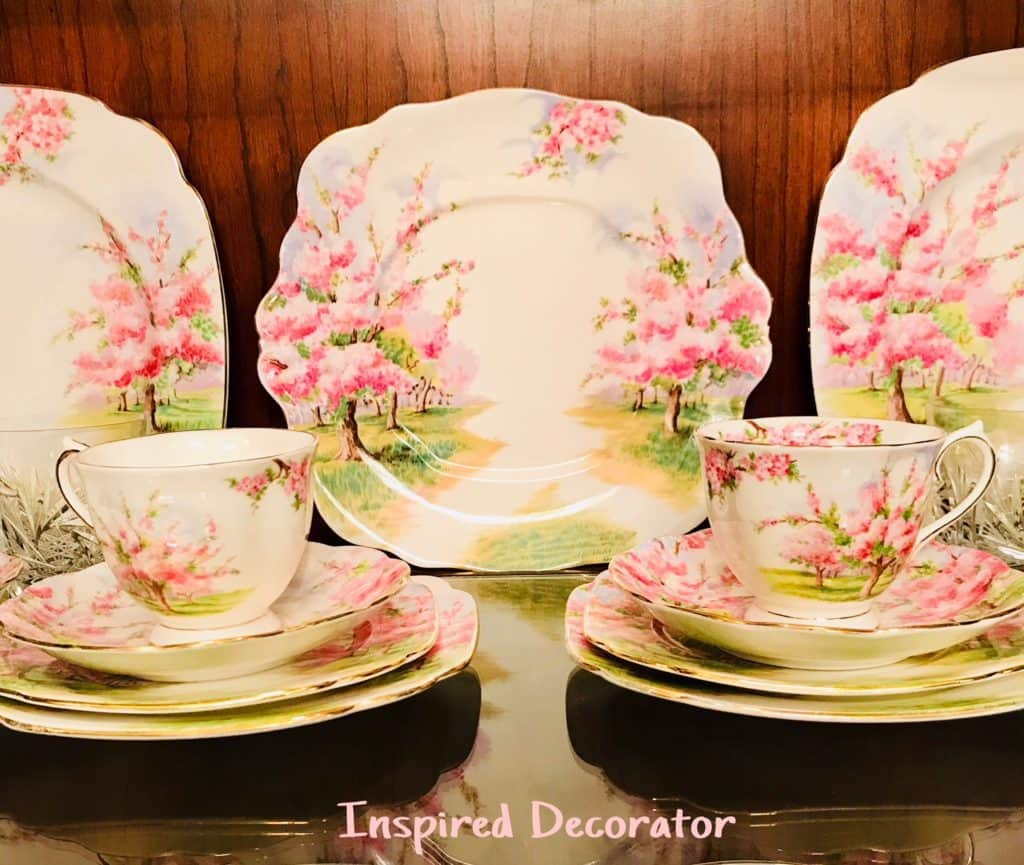 Heirloom China Dishes with Blossom Time Print on display in a rustic design styled home- inspireddecorator.com