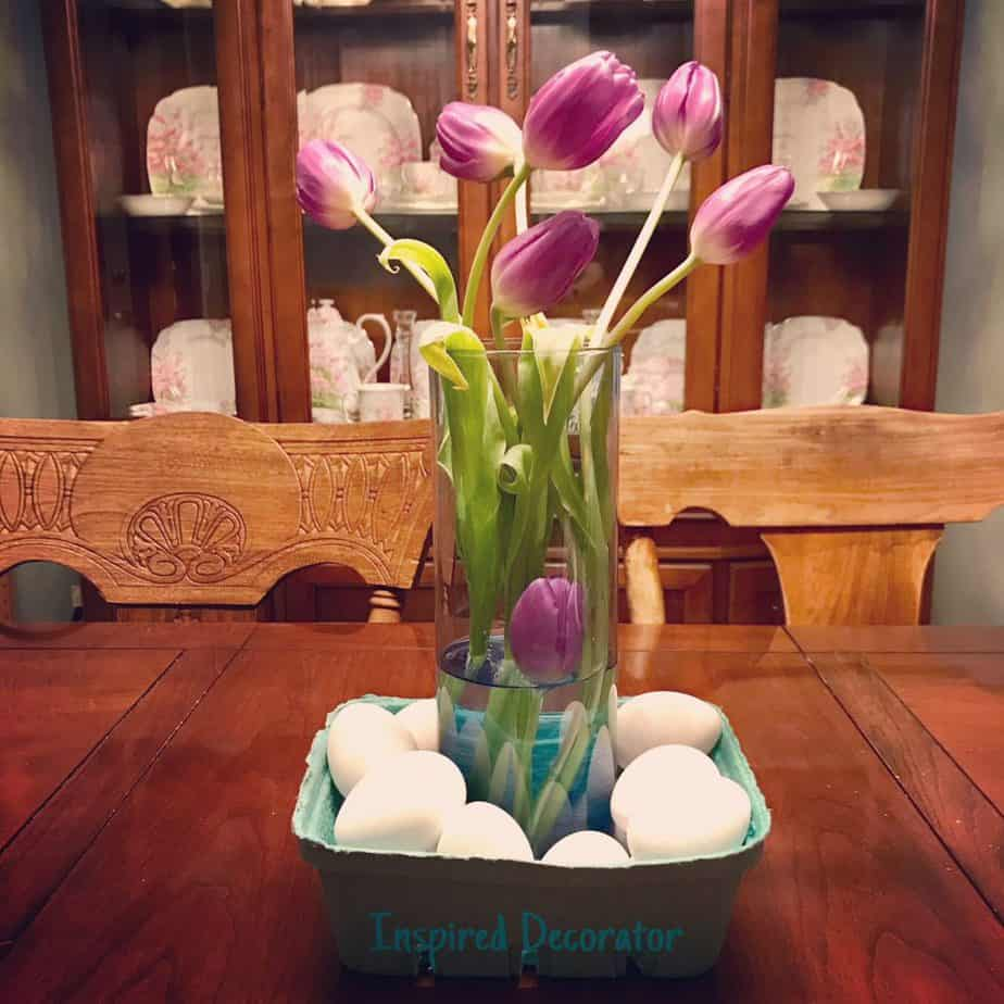A vase of fresh purple Tulips brighten up the dining room for spring