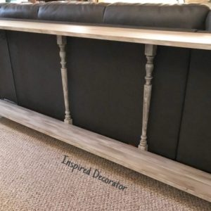 Extra stair spindles are cut down to fit as support legs for the new barnboard console table diy project www.inspireddecorator.com
