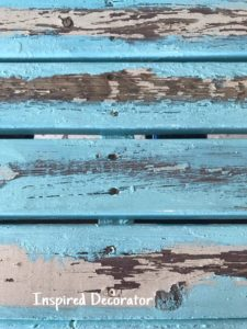 A beautiful distressed wood finish appears when the new paint is first applied to the old paint