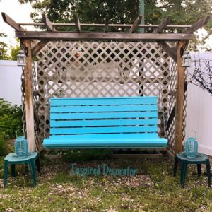 Porch swing painted in Benjamin Moore Pool Blue