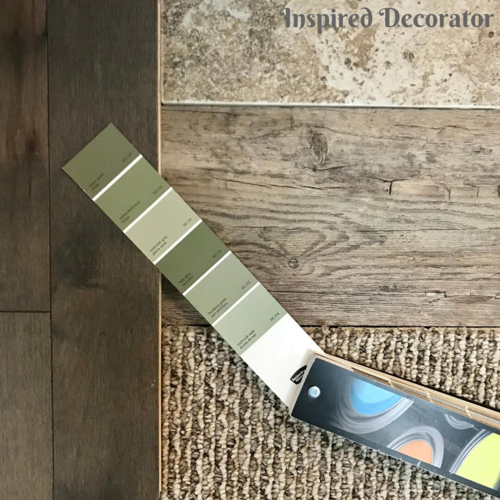 A comfy and cozy vibe is created with warm flooring, and inviting green walls www.inspireddecorator.com
