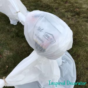 Setting up my ghost circle! Make sure any labels on your bags face away from the main view. For full ghost instructions check out my post on simple Halloween decorating! www.inspireddecorator.com