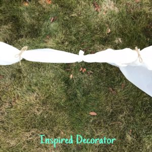 Here you can see I used twine to form and join the arms of my scary ghosts. They are simple Halloween ghosts using a shower curtain, newpaper, and dowels. For full ghost instructions check out my post on simple Halloween decorating! www.inspireddecorator.com