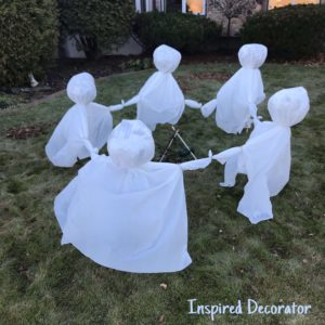 In the daylight this ghost circle doesn't seem as scary, but at night it comes to life! It's a simple and easy Halloween decoration to diy! For full ghost instructions check out this post on simple Halloween decorating! www.inspireddecorator.com
