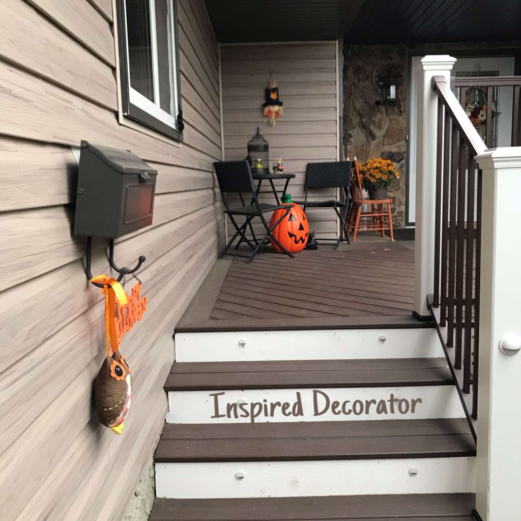 Some simple ideas for Halloween decorating! Small touches on this front porch to invite trick or treaters! Full instructions for making a creepy Halloween ghost circle check out this post! www.inspireddecorator.com