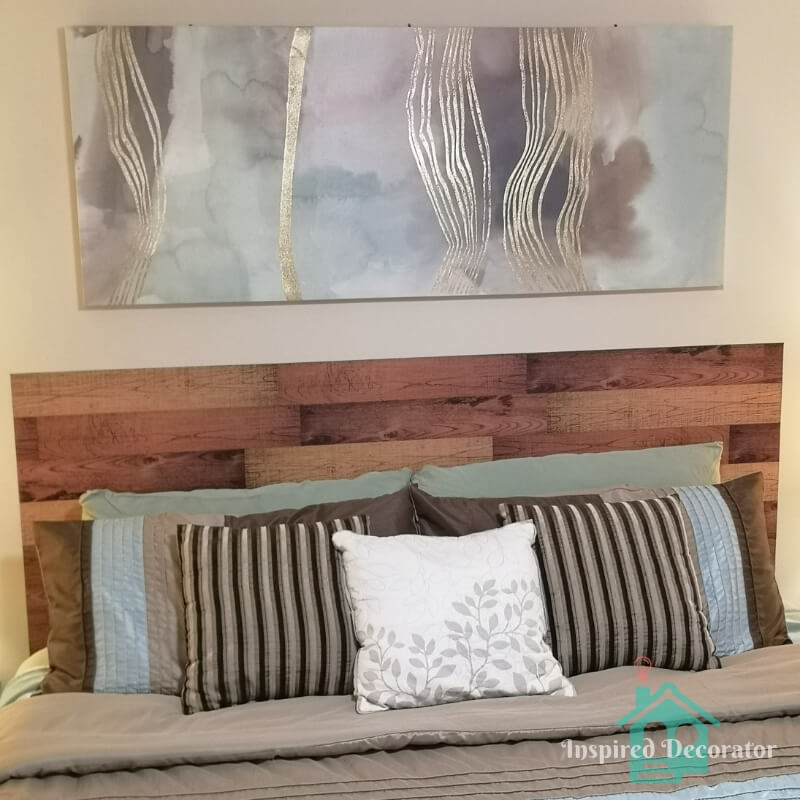"""This 60"""" wide canvas print is a great size to go over the king-sized bed. The blue, purple, and brown watercolor tones compliment the bedding as well as adding a gold sparkle to the guest room. www.inspireddecorator.com"""