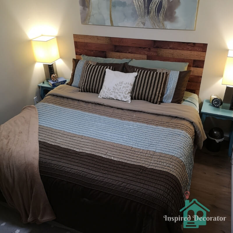 It is possible to create a welcoming guest room on a budget! This guest room was designed around the king-sized bed and inspired by the brown and blue bedspread. www.inspireddecorator.com