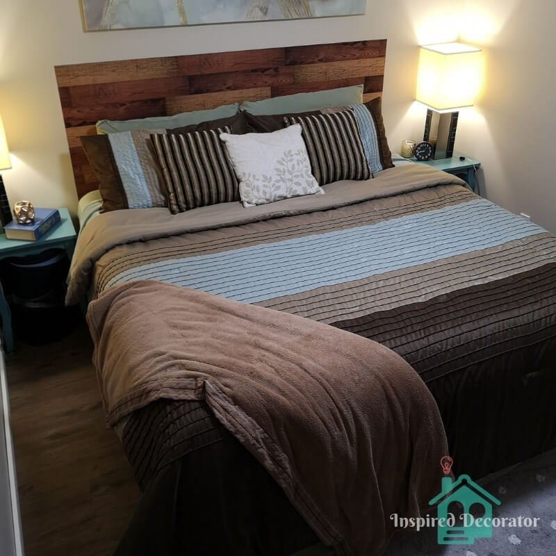 A large king-sized bed is located in the center of the room. It is the ultimate comfort item to welcome guests to the room with its cushion top and high-quality bedding.  www.inspireddecorator.com