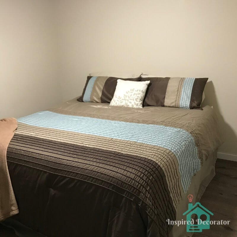 Before picture of the guest room. All it contained was the bed. Some home decor brought the room to life and make it welcoming for guests. www.inspireddecorator.com