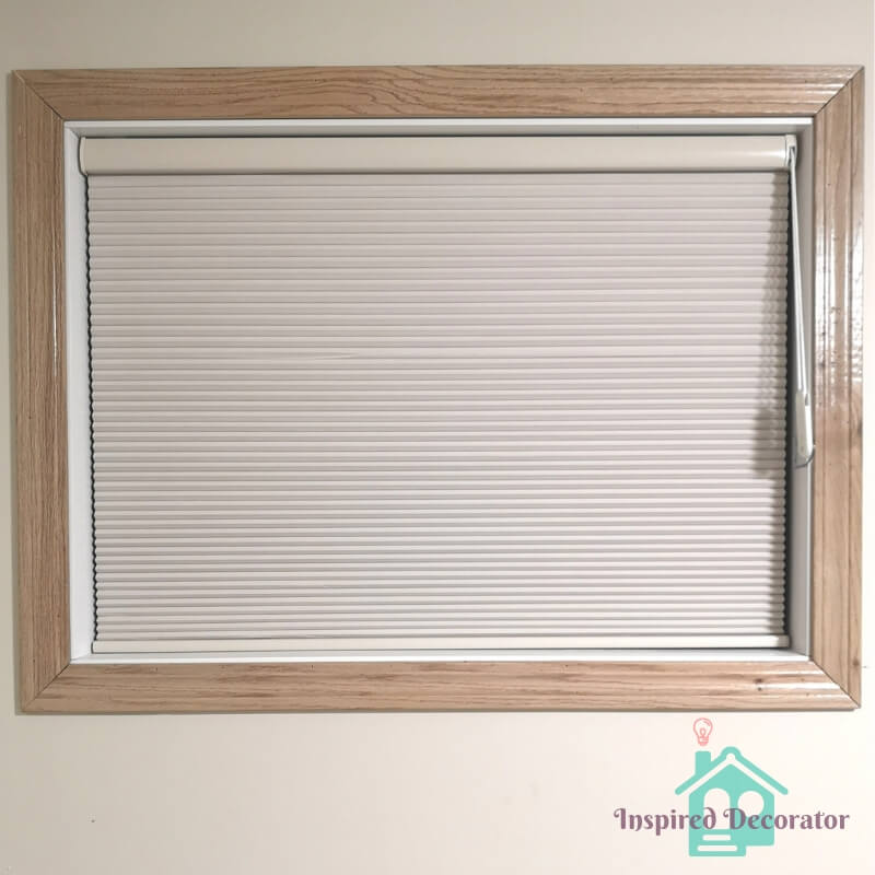 Habitat Blinds and Shading Honeycomb cellular shade, color Beechwood. This is a blackout blind that fits snug inside the window frame. www.inspireddecorator.com