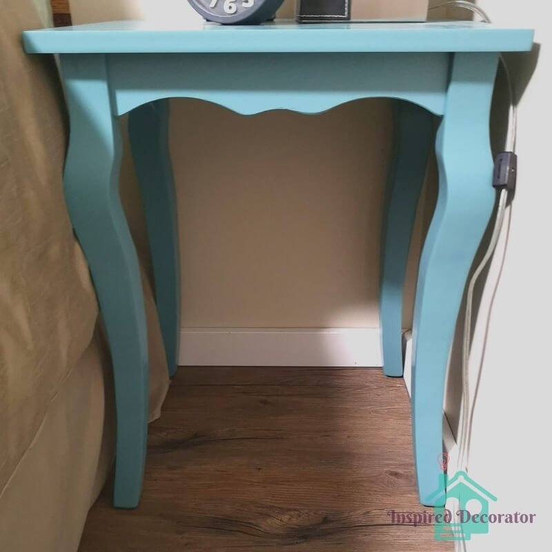 Two blue bedside tables fit on either side of the bed in the guest room. They are a bright teal blue for a pop of color! Accent furniture make great statement pieces. www.inspireddecorator.com