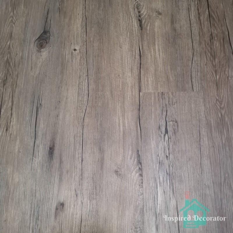 Ezlay Flooring luxury vinyl plank color Tiramisu. It is installed in the basement guest room. It's a beautiful rustic looking plank. www.inspireddecorator.com