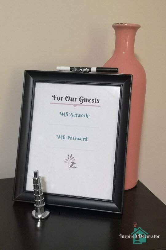 A DIY Wifi password sign for guests in kept in the guest room. Now they can easily access the wifi network without scrambling to find the password. Free Wifi Printable download is available! www.inspireddecorator.com