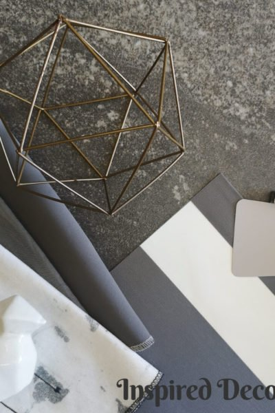 Moodboard Monday: Industry Gray. A monochromatic mood board featuring a variety of materials and finishes with the color gray being the anchoring feature. inspireddecorator.com