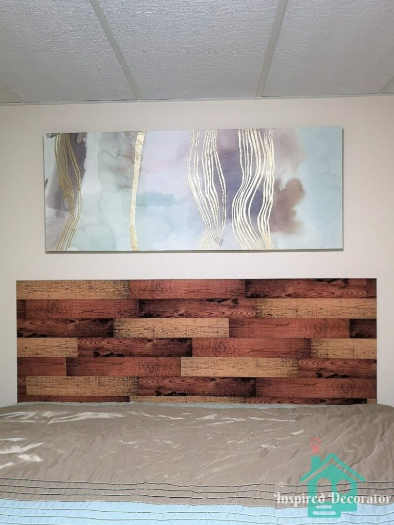 The diy vinyl decal plank headboard is complete! The crisp lines make it look more realistic as well as the staggered pattern of mixed colors. This headboard was completed in one evening for under $15. inspireddecorator.com