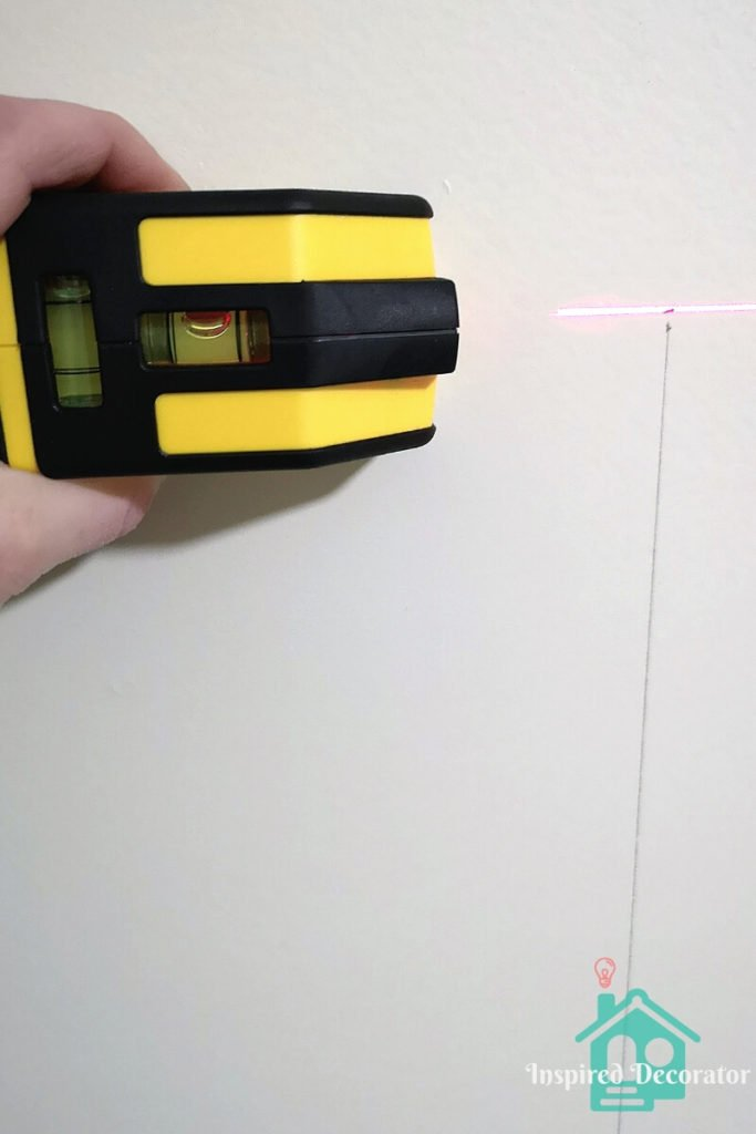 Using a laser level helps to make sure your lines are straight. Especially for long lines such as with this diy headboard. inspireddecorator.com