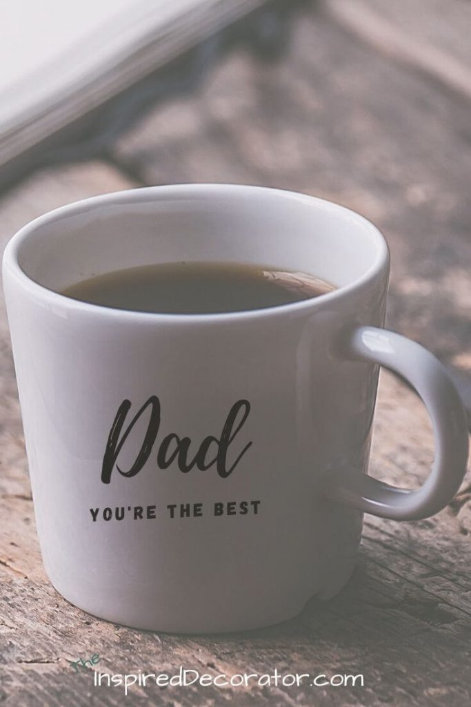 A warm cup of coffee waits inside a coffee mug labeled Dad, You're The Best. A great DIY Father's Day gift idea.