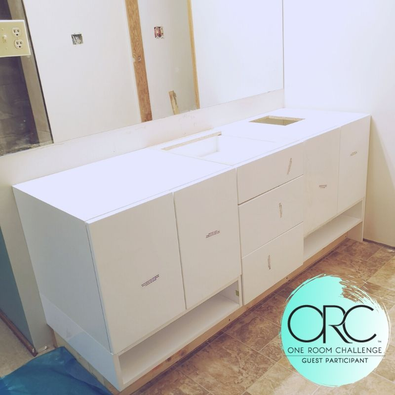 The vanity is assembled and in place. This is the Soho Gloss White from KitchenCraft.