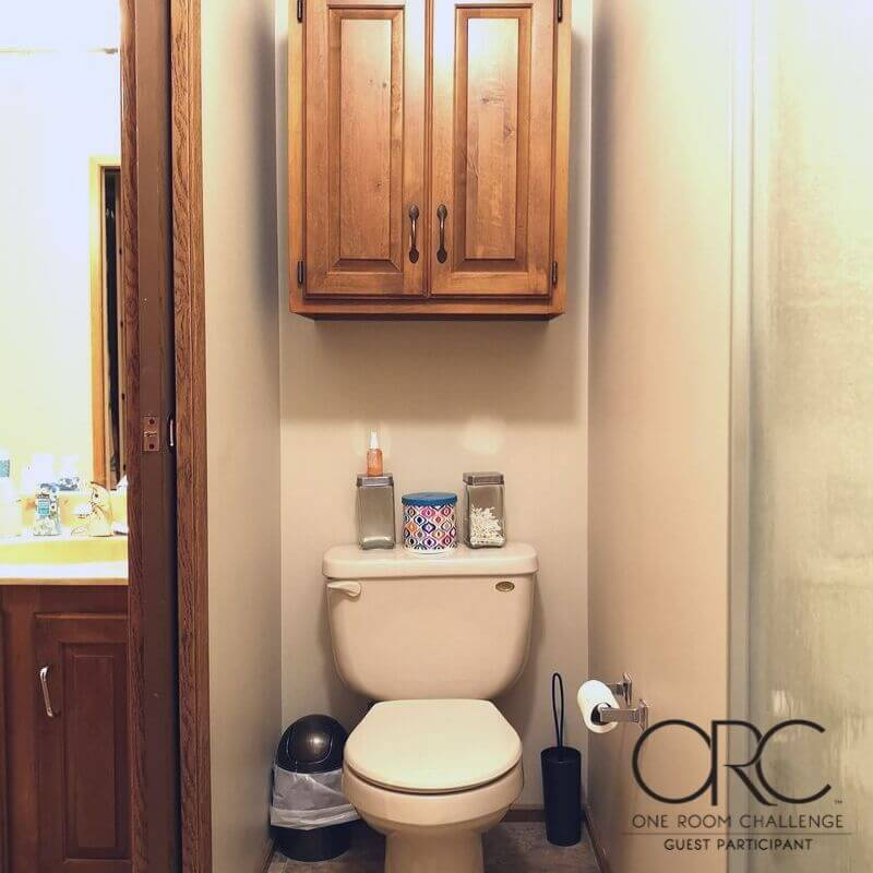 The toilet area is closed off from the open bathroom-bedroom area by an oak pocket door.
