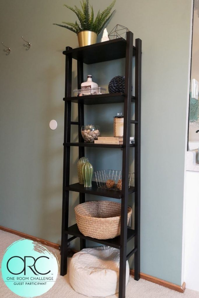 This simple shelving unit is the only surface and display area in the bedroom area. This eliminates areas for clutter to gather so the master sutie can maintain its simple and peaceful atmosphere.