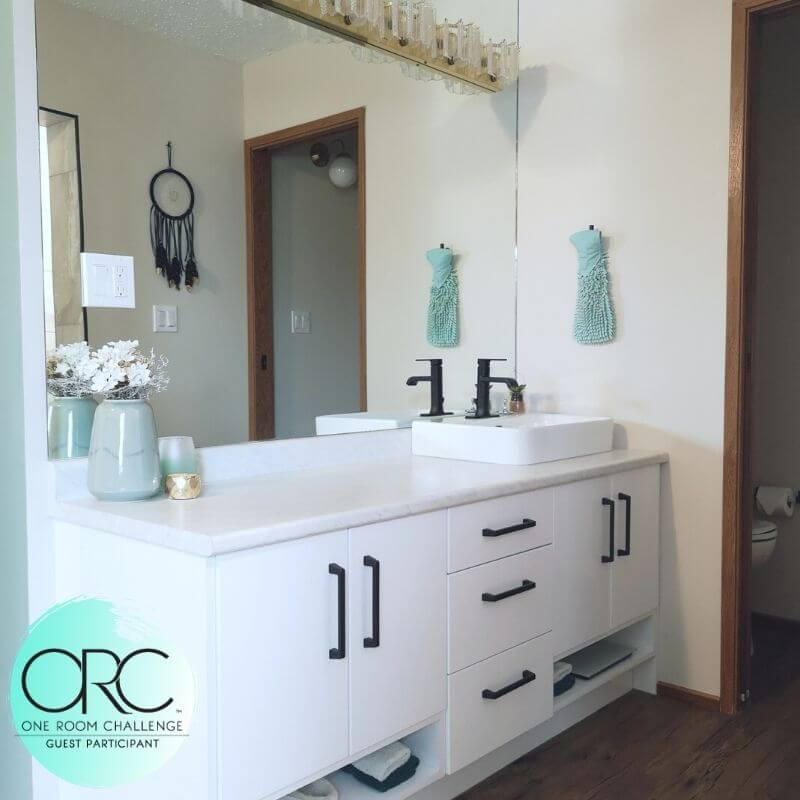 The matte black handles and faucet provide a beautiful contrast to the glossy white vanity.