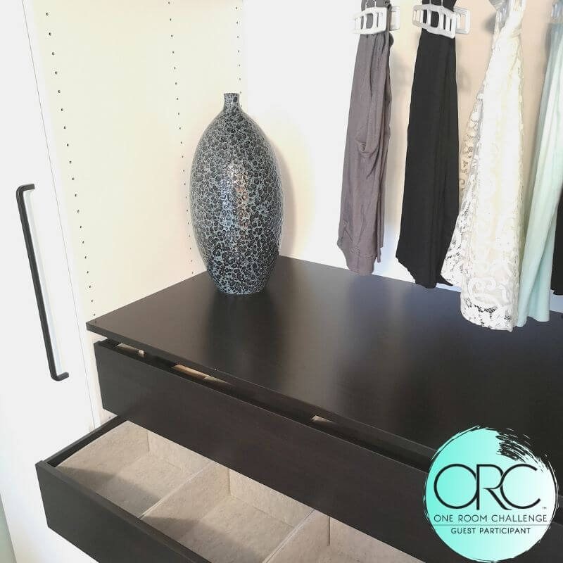 For some interest and contrast, the dark finish was chosen for the inner drawers in the closet units.