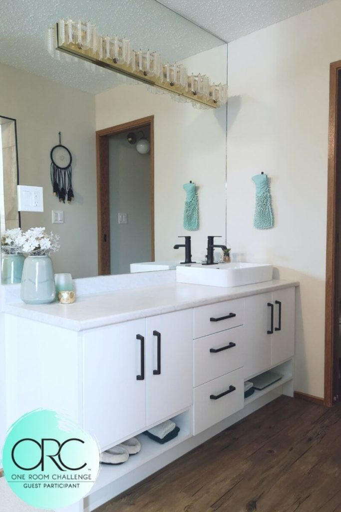 The glossy white vanity provides lots of storage room in this newly renovated shabby chic style bathroom.