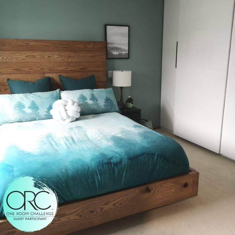 A bright and bold bedroom adds color and interest to the otherwise neutral master suite. The open concept design allows for plenty of movement and light.