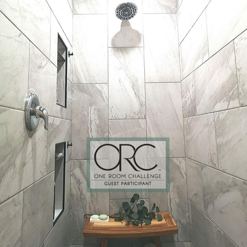 A spacious walk-in shower has a beautiful spa feel right at home. It was converted from a walk-in shower for the One Room Challenge guest participant renovation.