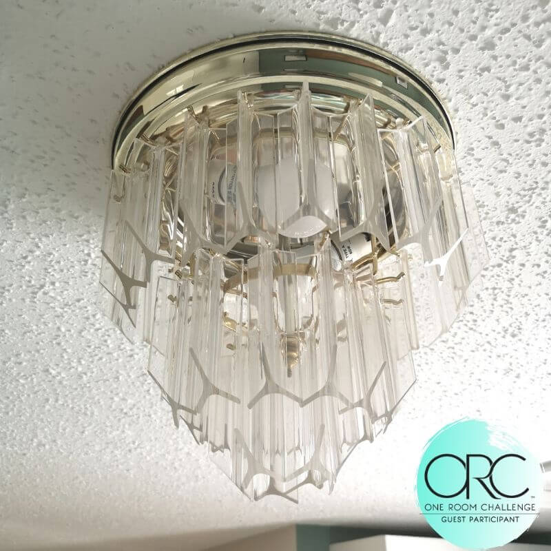 One of the design challenges was the the original light fixtures were being kept as a nod to the history of the home. The rest of the design was created to blend them in with the rest of the new style.