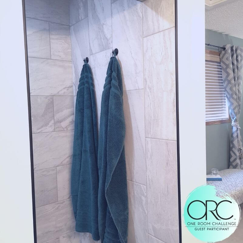 An area at the shower entrance is designed for a drying off area after showering.The warm stone floor quickly dries after you leave.