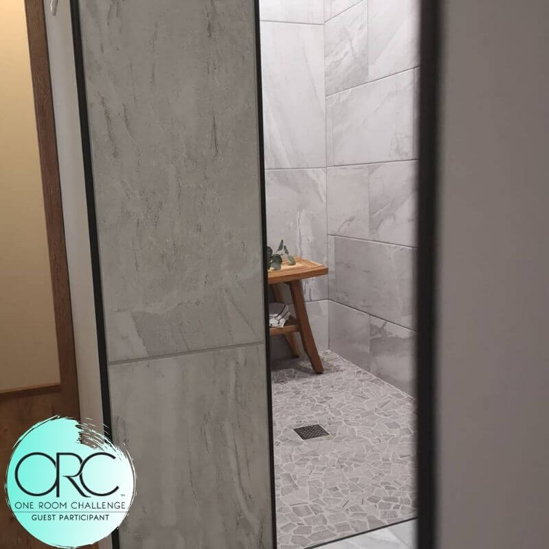 A glimpse around the corner from the main bathroom area into the walk-in shower