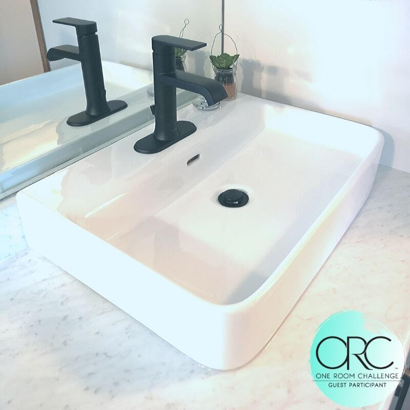 The simple lines of the crisp white sink compliment the sharp lines of the matte black faucet.