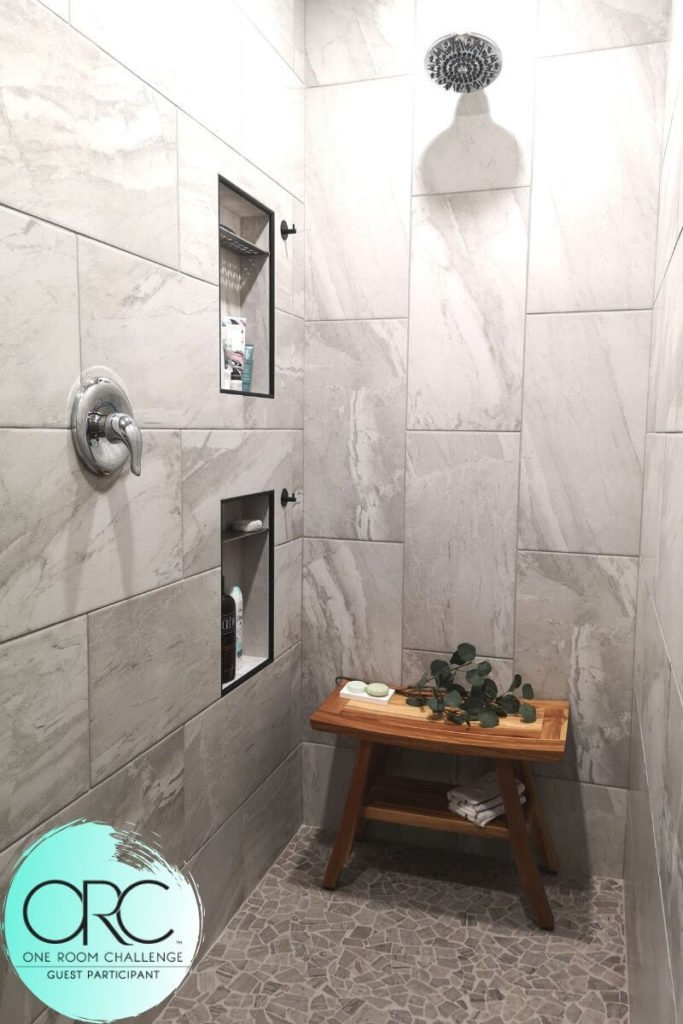 The walk-In spa shower comes to life with soft grey stone-like tiles in a wrap-around pattern and marbles stones on the floor.