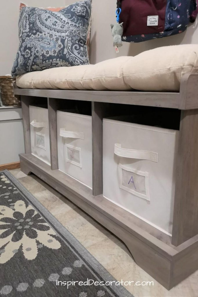 A bench in the mudroom is a great idea for anyone needing to sit to put on shoes. This one has storage to hide the mess of mitts, hats ,and leashes. It's underneath the family command center which is the central organizing hub.