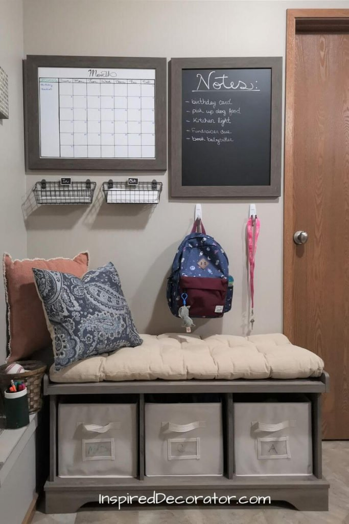 A section of the mudroom was turned into the family command center. It's simple and function with a large diy whiteboard calendar, chalkboard for notes,  an area for mail sorting, designated backpack location, and a bench with bins for gloves and mitts.