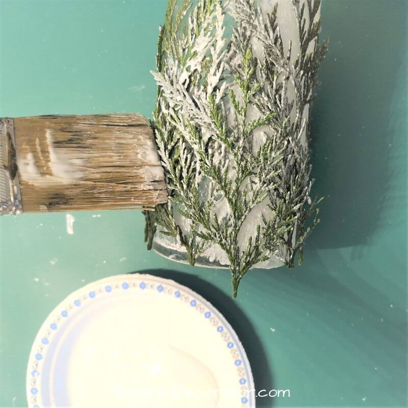 This Mod Podge will dry clear so go ahead and be heavy-handed with it. Work in layers to get a good adhesion between the candle holder and the layers of leaves.