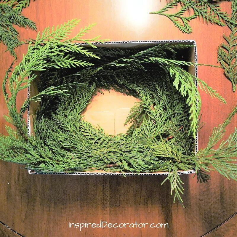 Use real white pine needles for a wispy appearance in your Christmas centerpiece