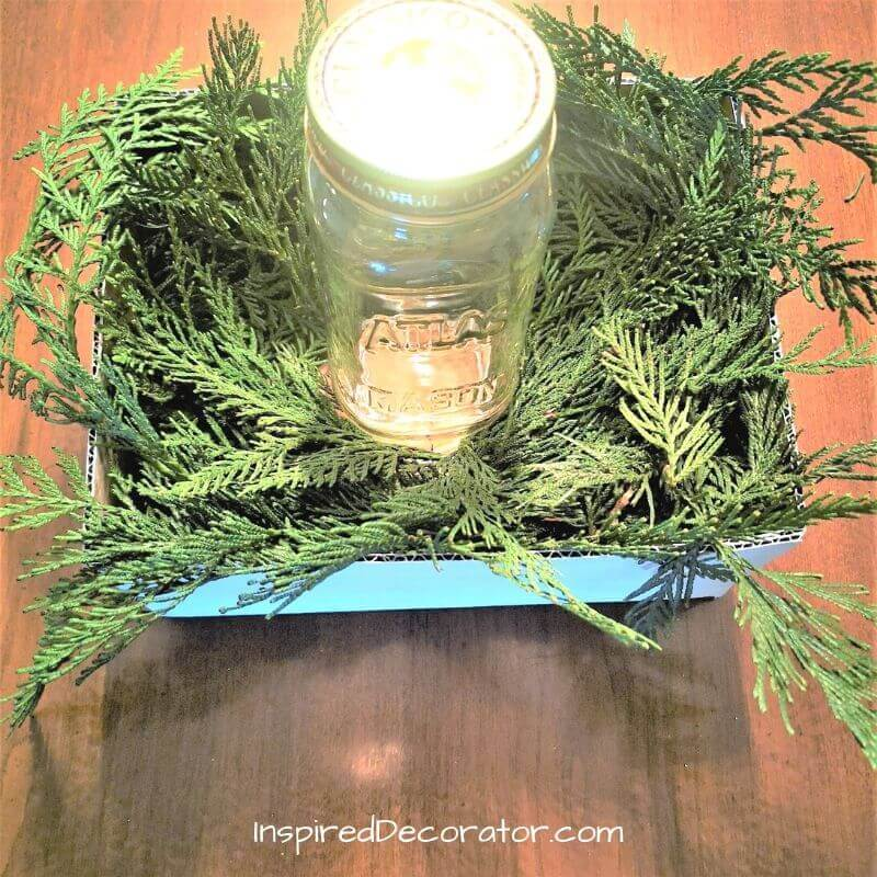 A mason jar, candleholder, or vase gives some height and focus to your Christmas centerpiece.