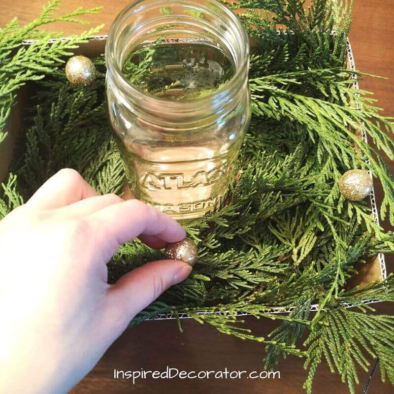 Sparkly balls are a great way to fill in gaps, add glitz, and give your centerpiece character