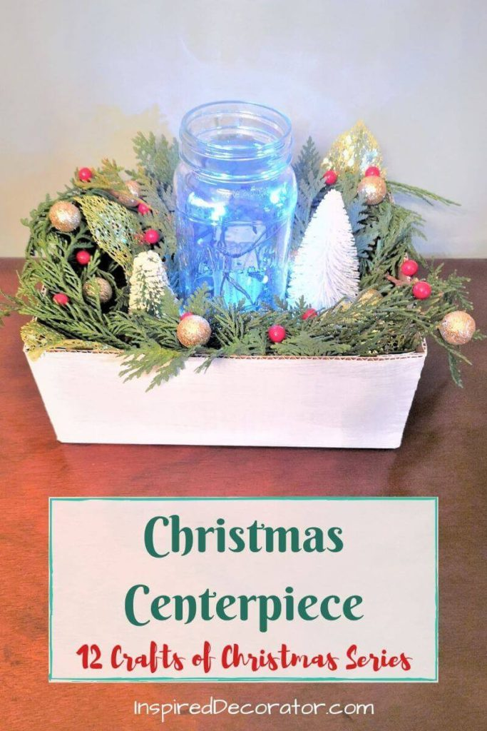Set the mood at the Christmas table with a beautiful DIY Christmas Centerpiece! Day 12 of the 12 Crafts of Christmas DIY Home Decor series.