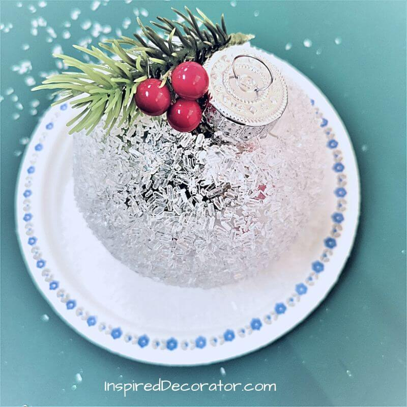 Alongside the sprig of pine, a few berries add some color to the epsom salt Christmas ornament