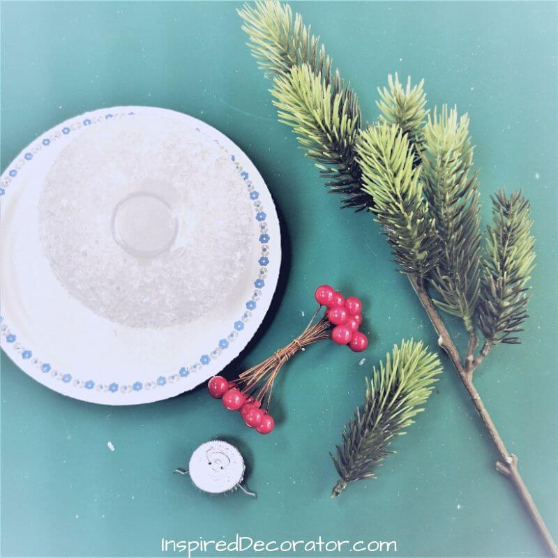 Decorate your frosted Christmas all with springs of pine and berries. Be as creative as you wish.
