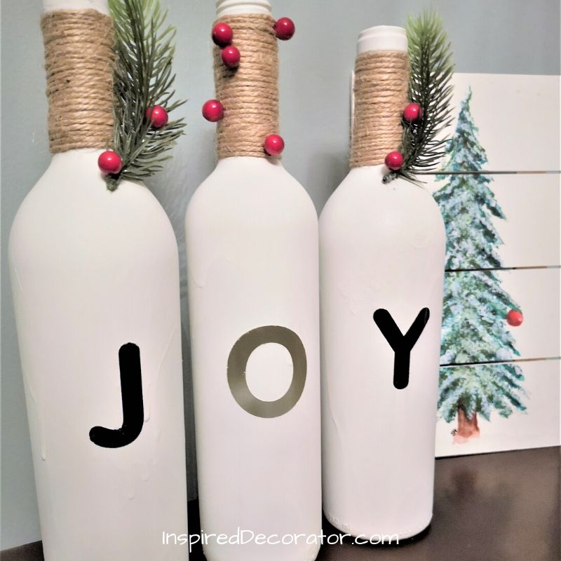 Bring Joy to the world with these diy Christmas Joy Wine Bottles display. Its a whimsical way to gift joy this holiday season .  -the Inspired Decorator