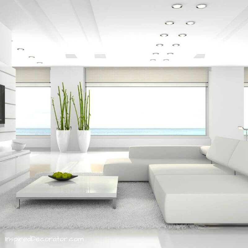 A clean, white and undecorated living room feels modern and positive.