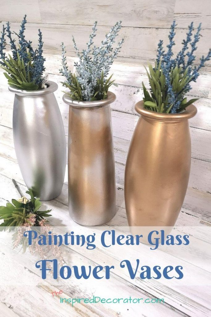 Use spray paint to makeover your decor. Clear glass flower vases are giving a metallic touch with a few coats of spray paint. It's an easy way to update boring decorations. - the Inspired Decorator