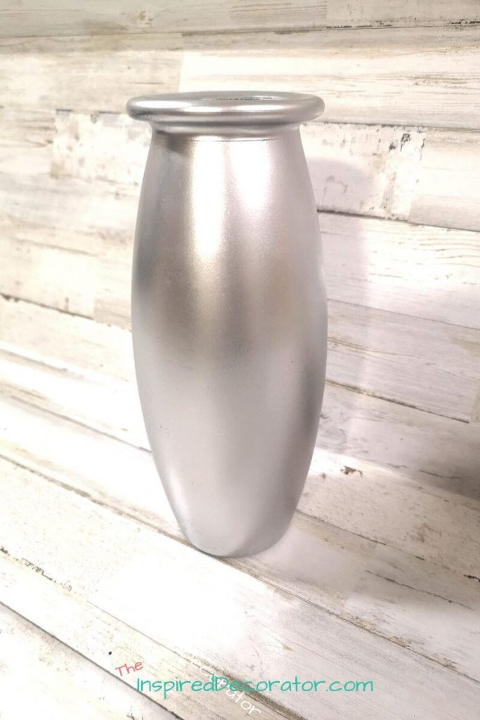 A clear vase now shows its silver lining thanks to a Krylon metallic silver spray paint. - the Inspired Decorator