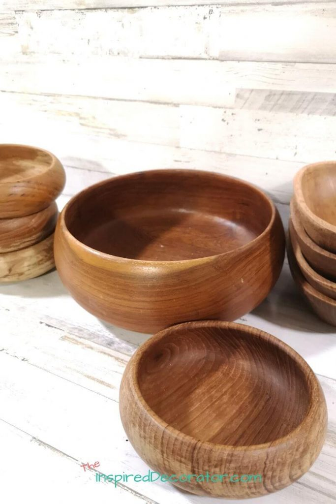 A great find at the thrift store included getting all of these wood bowls for $5. There are so many potential projects that they can be used for. - the Inspired Decorator