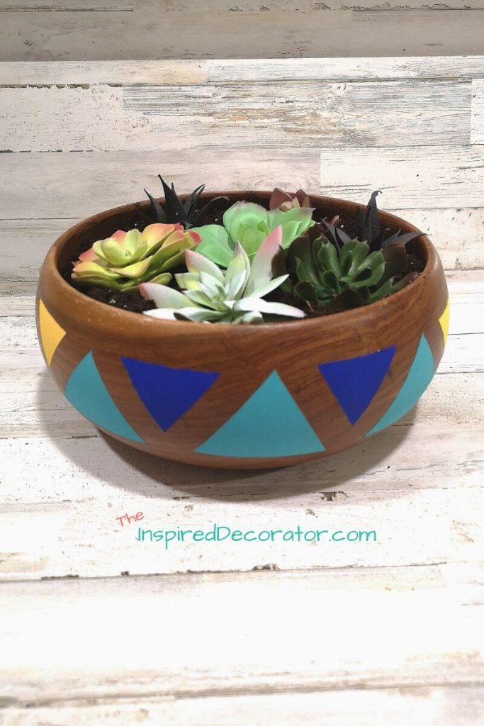 Add colour and style to your home with a painted wooden bowl succulent planter. Succulents are low maintenance and this wood bowl is easy to decorate. A great diy thrift flip idea. - the Inspired Decorator